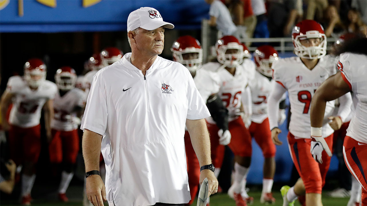 Fresno State head coach Jeff Tedford enters the field with his team before the start of an NCAA college football game against UCLA, Saturday, Sept. 15, 2018, in Pasadena, Calif.