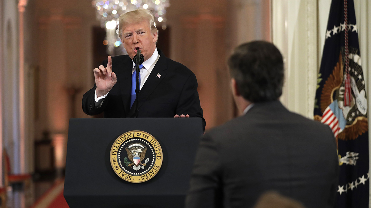 President Donald Trump speaks with CNN White House correspondent Jim Acosta during a news conference in the East Room of the White House, Wednesday, Nov. 7, 2018, in Washington.