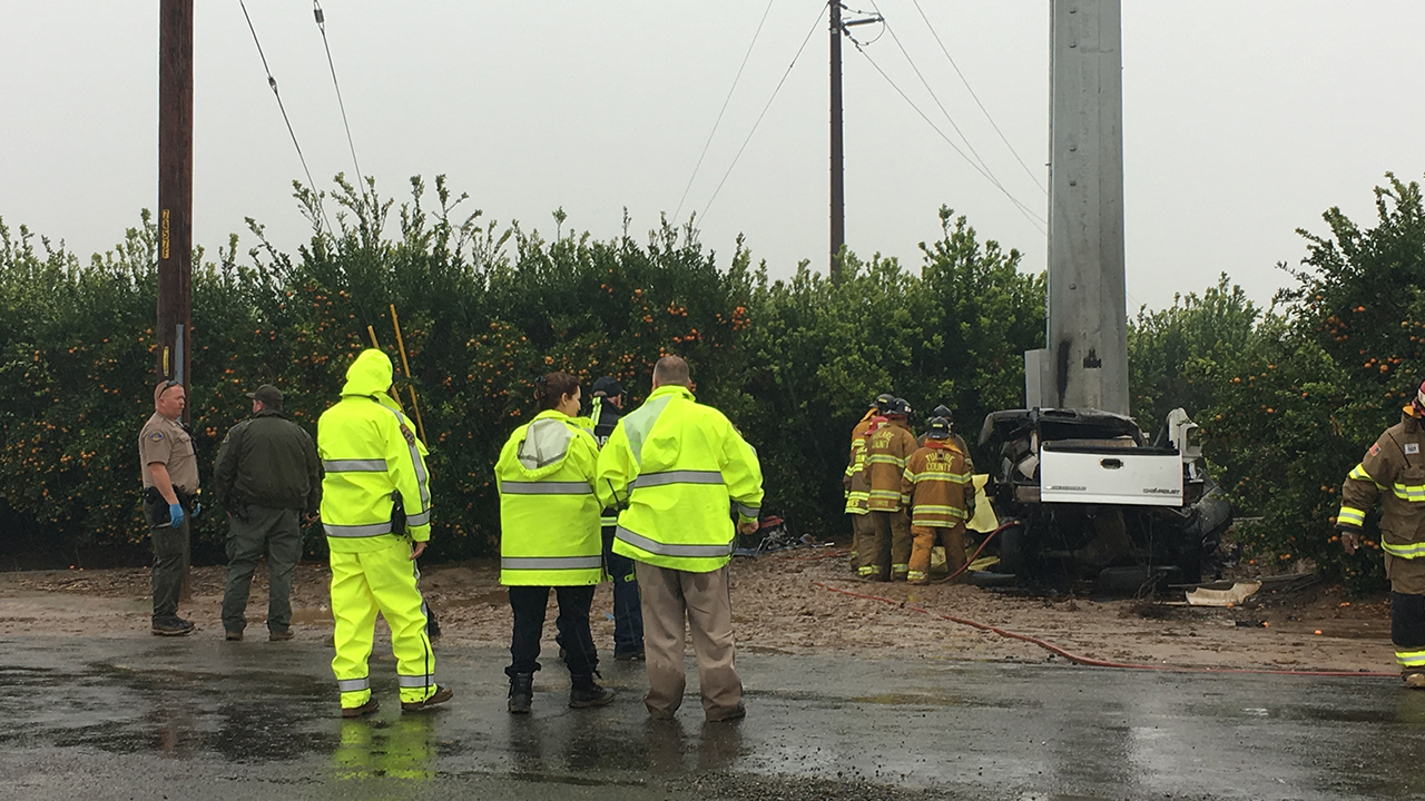 Two people are dead after their car crashed into a large power pole and burst into flames near Dinuba, California Highway Patrol says.
