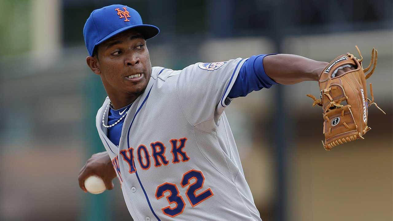 New York Mets relief pitcher Jenrry Mejia (32) winds up during the sixth inning of an exhibition spring training baseball game against the Detroit Tigers, Monday, March 11, 2013