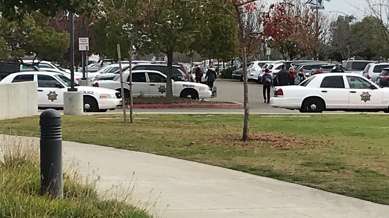 Police cars parked in front of the Clovis North High School campus in Northwest Fresno amid an investigation into reports of threats to five students.