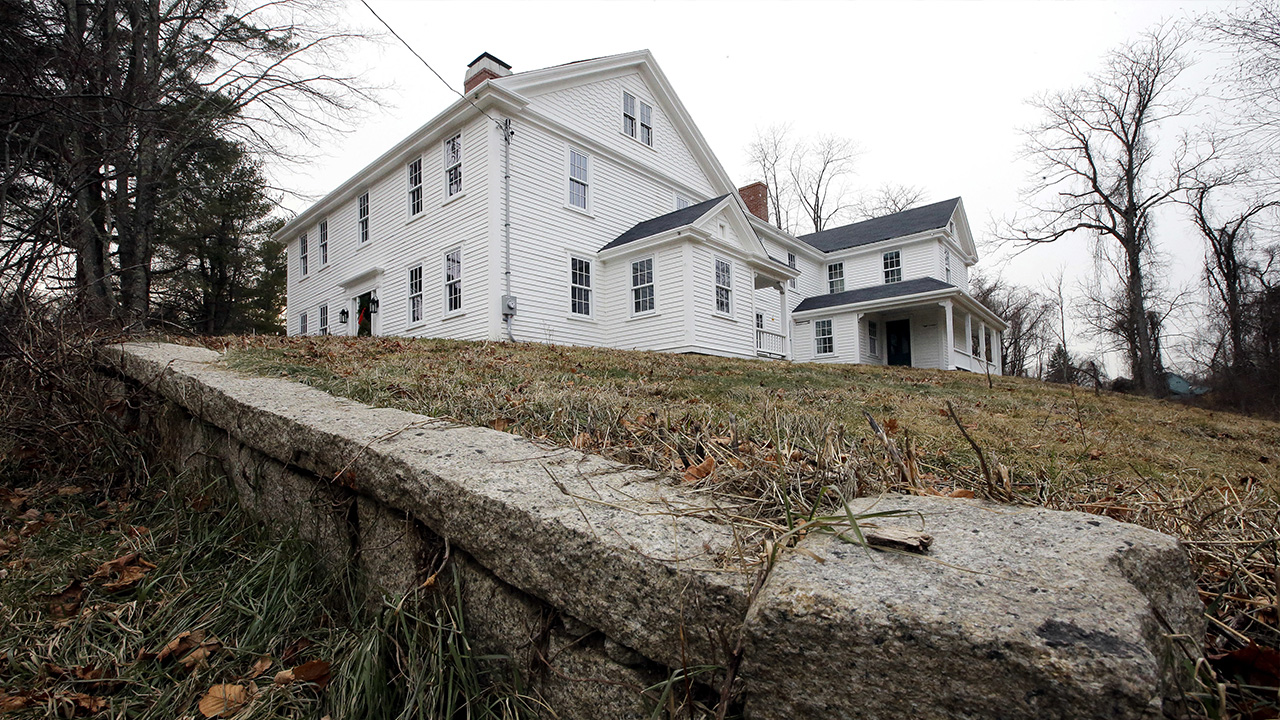 In this Thursday, Dec. 13, 2018 photo a wall stands near the home where Sarah Clayes lived, in Framingham, Mass., after leaving Salem, Mass., following the 1692 witch trials.
