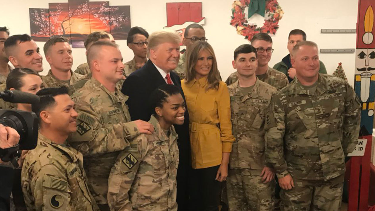 President Trump and the First Lady post for a picture with servicemembers in Iraq during an unannounced visit to the troubled region on December 26, 2018.