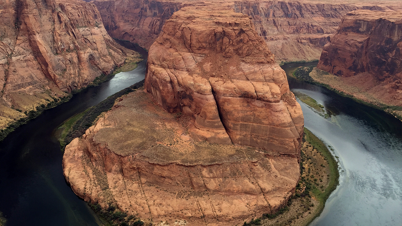 This Aug. 27, 2016, photo shows Horseshoe Bend near Page, Ariz. Authorities say a California girl visiting the Arizona landmark has died from what appears to be an accidental fall.