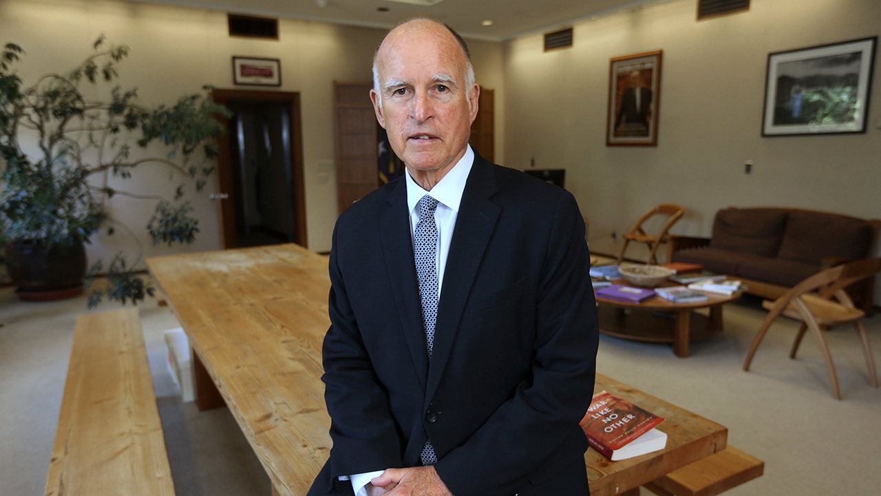 FILE - In this May 28, 2014, file photo, Gov. Jerry Brown poses in his Capitol office in Sacramento, Calif. Brown leaves office Jan. 7, 2019.