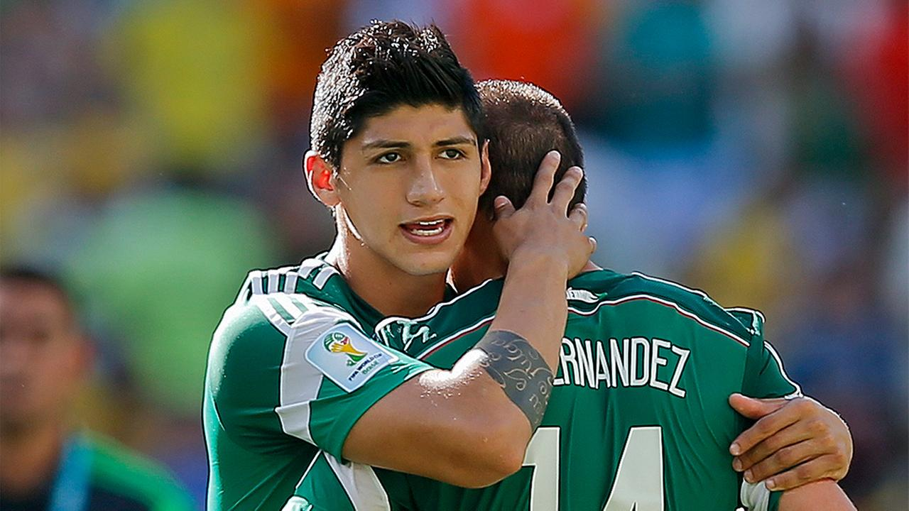 In a June 29, 2014 file photo, Mexicos Alan Pulido consoles teammate Javier Hernandez (14) after the Netherlands defeated Mexico 2-1 during the World Cup round of 16 soccer match.
