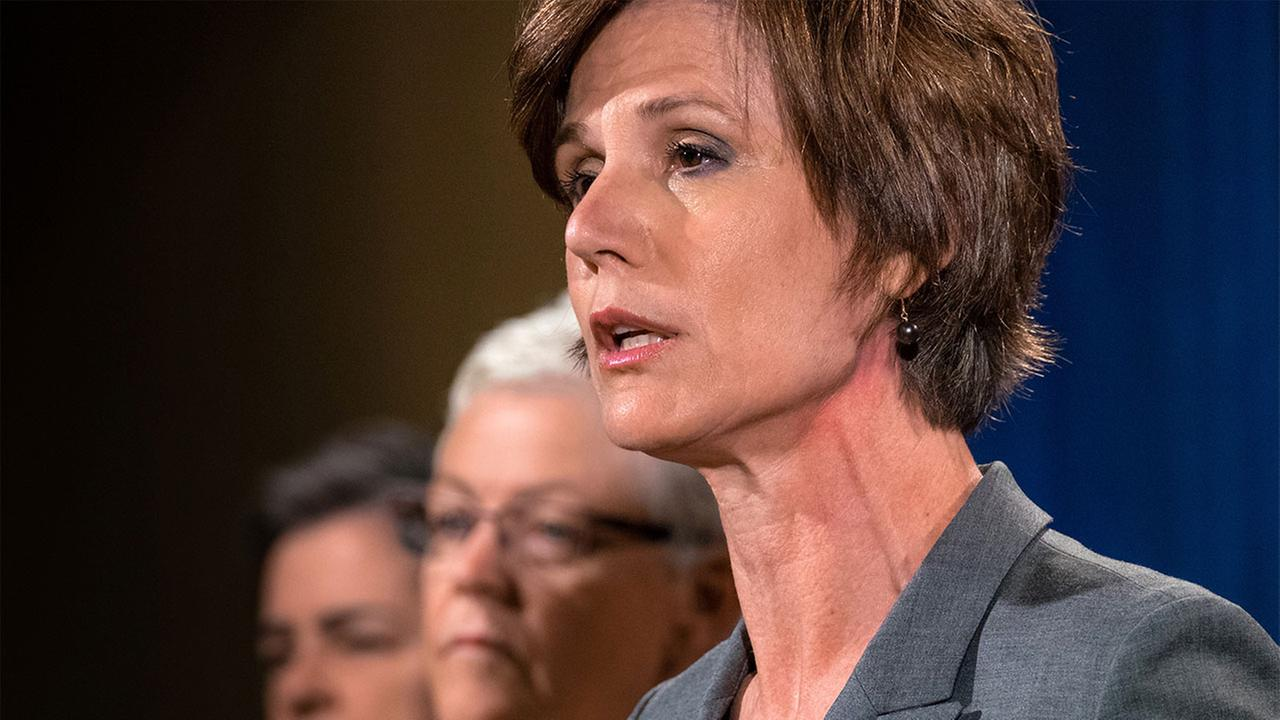 Deputy Attorney General Sally Yates, right, announces the settlement with Volkswagen during a news conference at the Justice Department in Washington, Tuesday, June 28, 2016