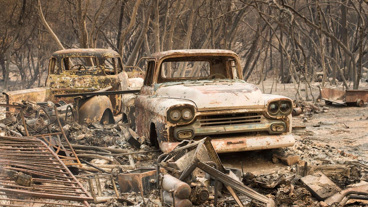 The fast-moving wildfire in the Sierra Nevada foothills destroyed structures and homes.