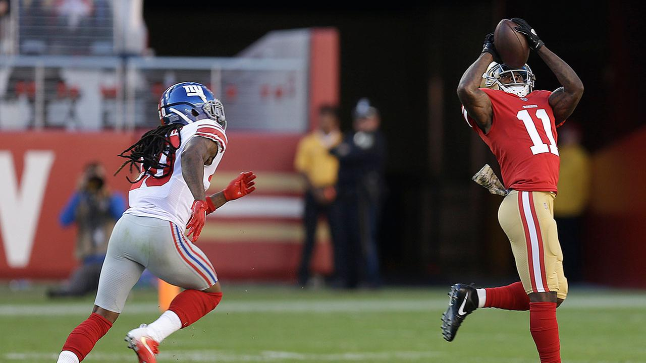 San Francisco 49ers W/R Marquise Goodwin (11) catches a touchdown pass in front of New York Giants cornerback Janoris Jenkins, left, during the first half of an NFL football game