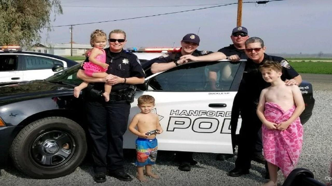 "Little Hanford boy who ""loves Police officers and his sister"" gets a visit from some officers and a gift"