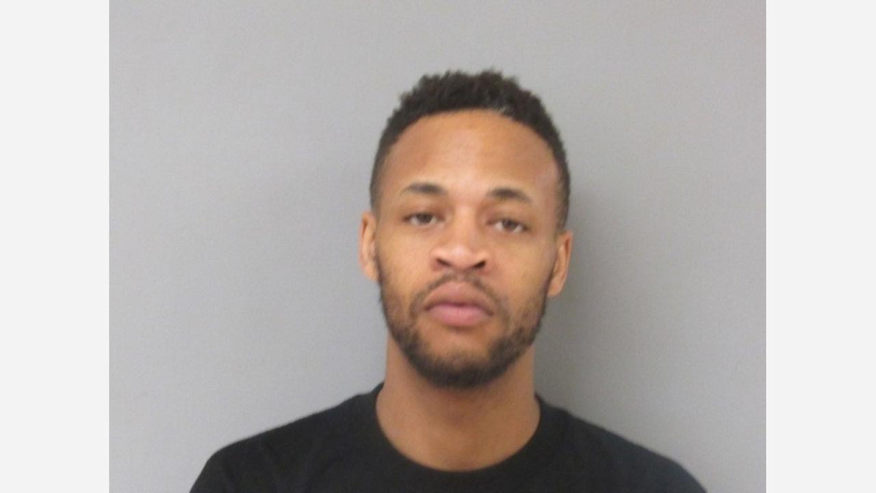 Gregory Smith, 27-years-old, is accused of assaulting an employee on the campus of Cesar Chavez School and then leading officers on a short chase.