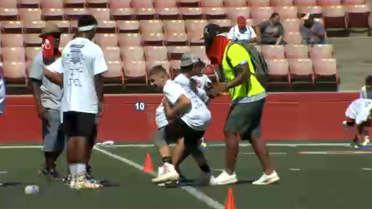Valley kids learn proper techniques from professional players during clinic