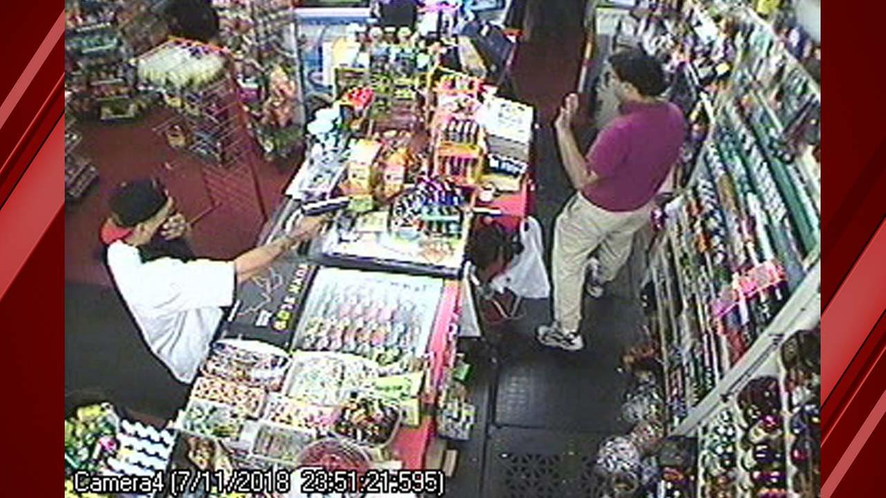 Suspect holds store clerk at gun point during robbery in Hanford