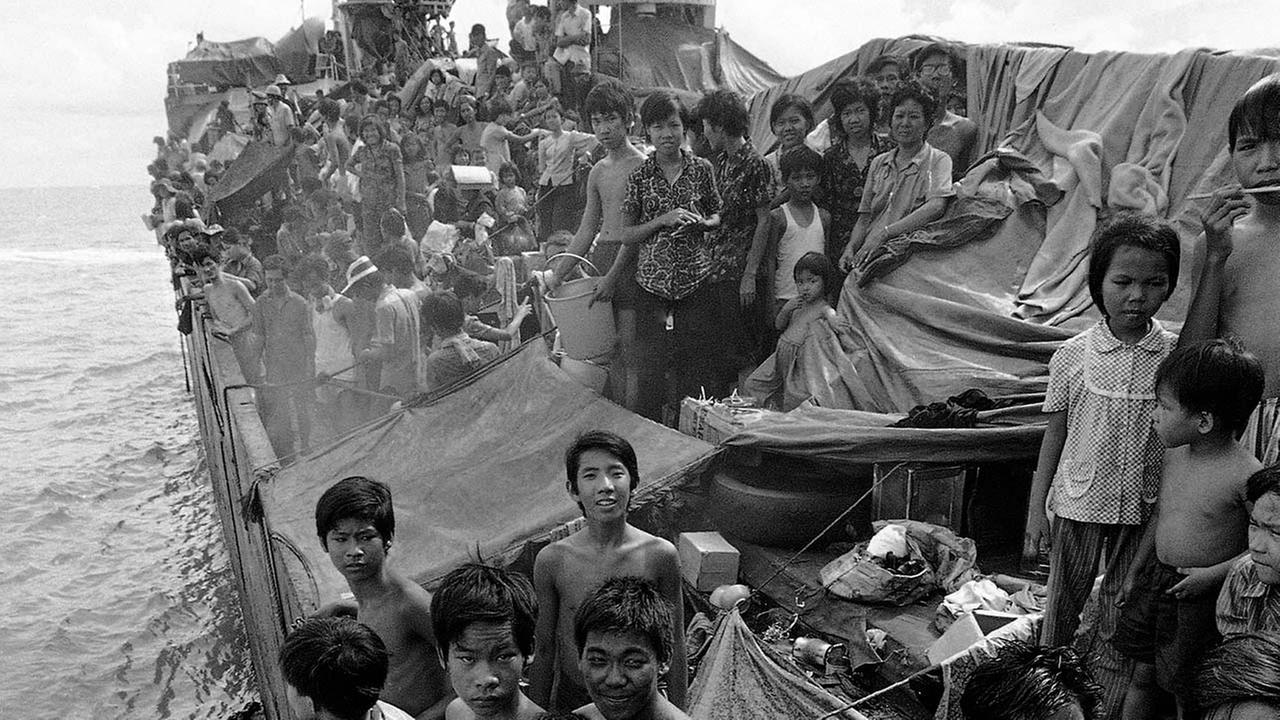 In this Nov. 22, 1978, file photo, Vietnamese refugees crowd deck of freighter Hai Hong, as the vessel rides at anchor off Port Klang, Malaysia. (AP Photo/Jeff Robbins, File)
