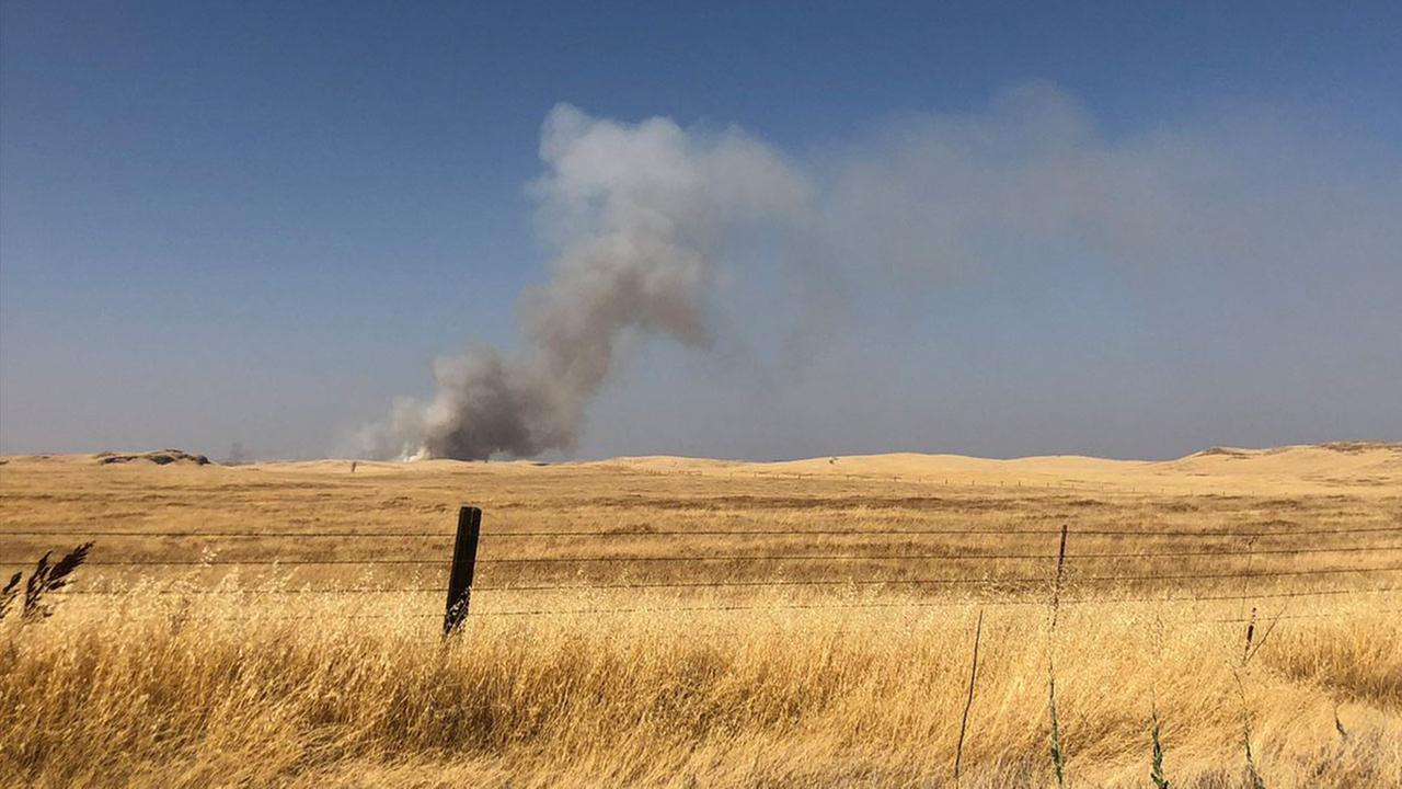 Image of a 100-acre grass fire southwest of the Madera County community of Raymond