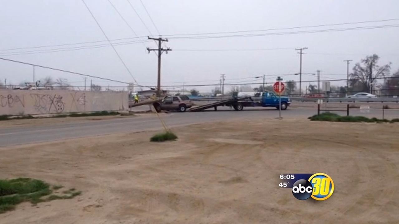 SUV slams into power pole, snarls traffic on Highway 198 in Visalia