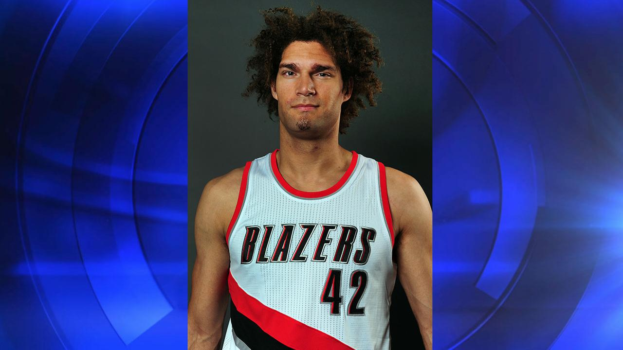 Portland Trail Blazers center Robin Lopez (42) poses for a photograph during the NBA basketball teams media day in Portland, Ore., Monday, September 29, 2014.