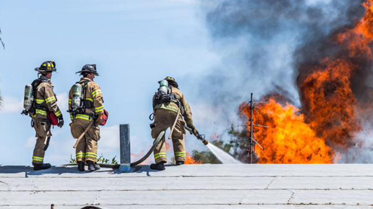 Firefighters battled a house fire in Downtown Fresno on Sunday, April 26, 2015.