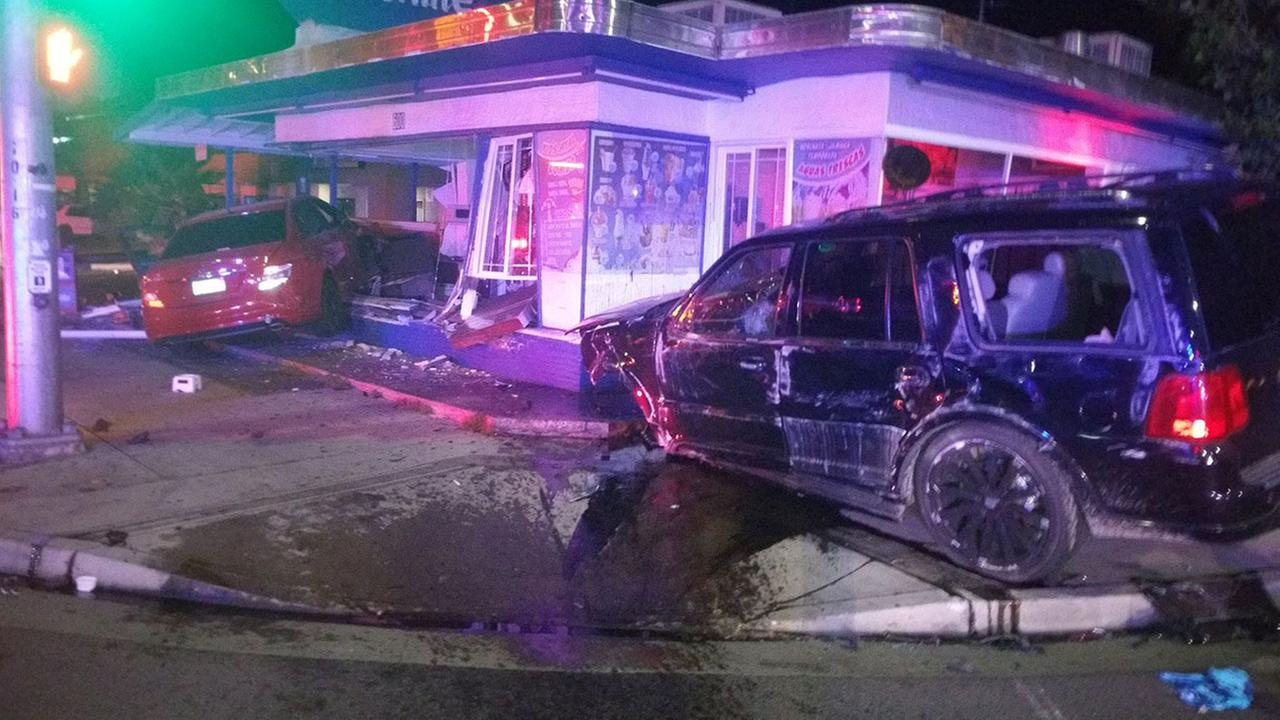 Authorities investigate a car crash that damaged a business in Madera on Saturday, May 2, 2015.
