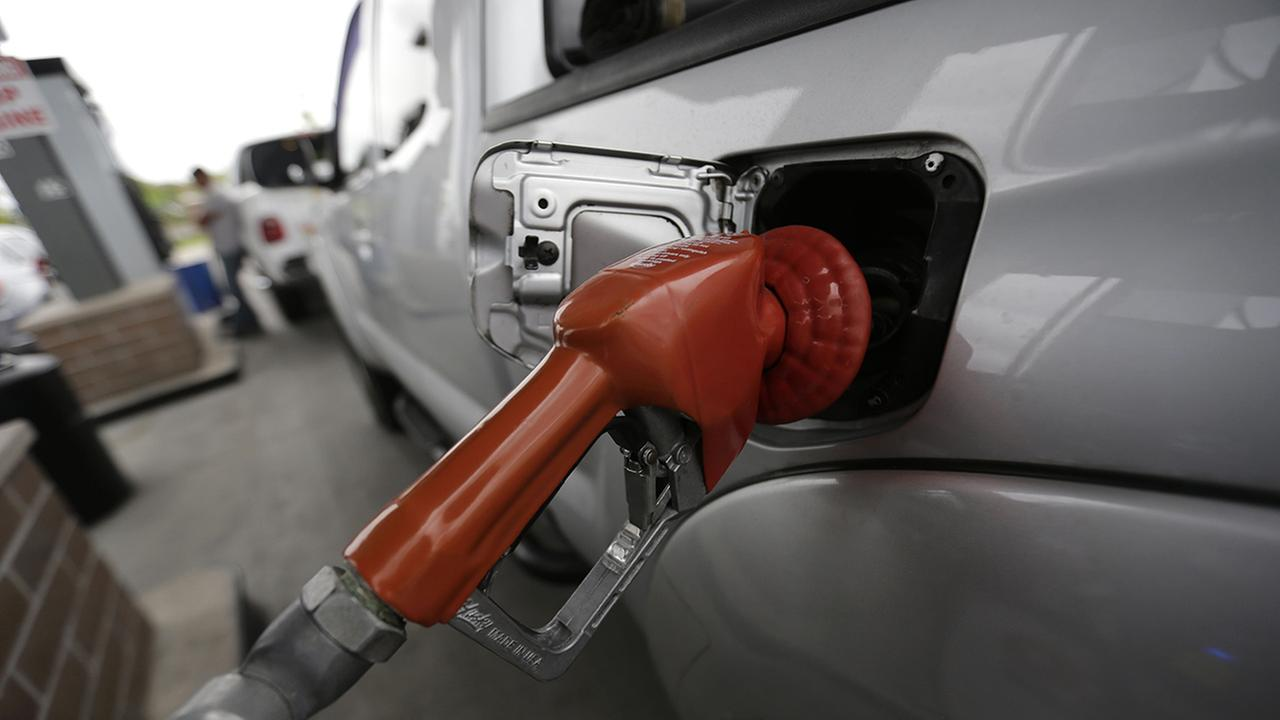 FILE - In this April 6, 2015 file photo, a vehicle is refueled at a gas station in New Orleans.