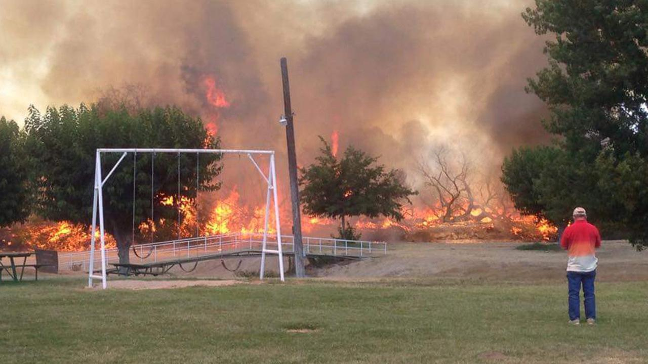 A fire broke out near the Kings River on Monday, June 22, 2015.