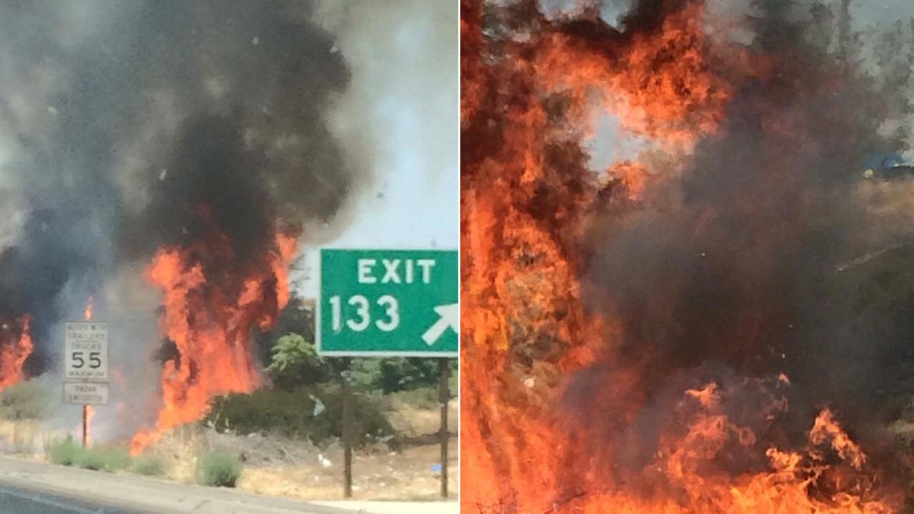 A grass fire broke out near the Highway 99 and Highway 180 interchange in Downtown Fresno on Saturday, Aug. 8, 2015.
