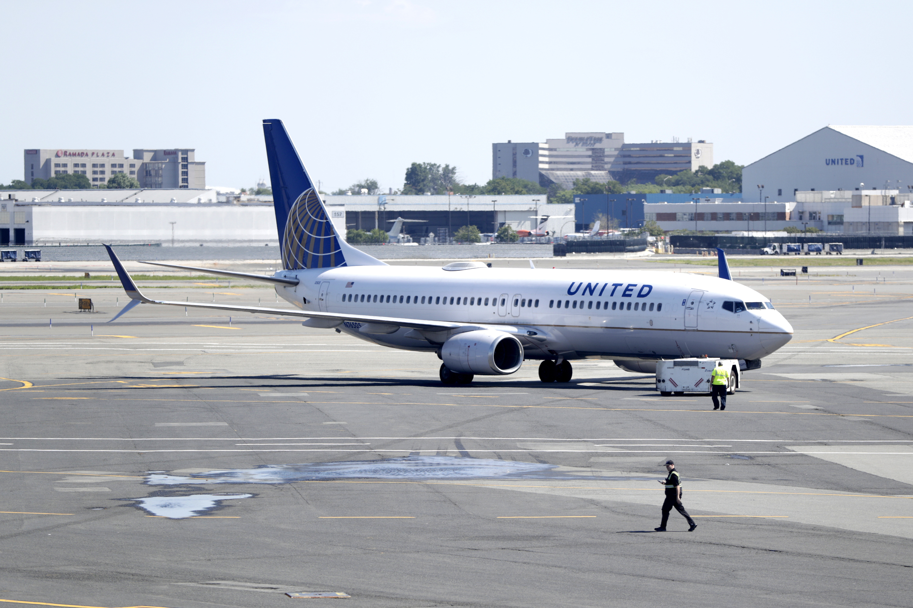 A United Airlines commercial jet taxis away from Terminal C before lift-off at Newark Liberty International Airport, Wednesday, July 18, 2018, in Newark, N.J.