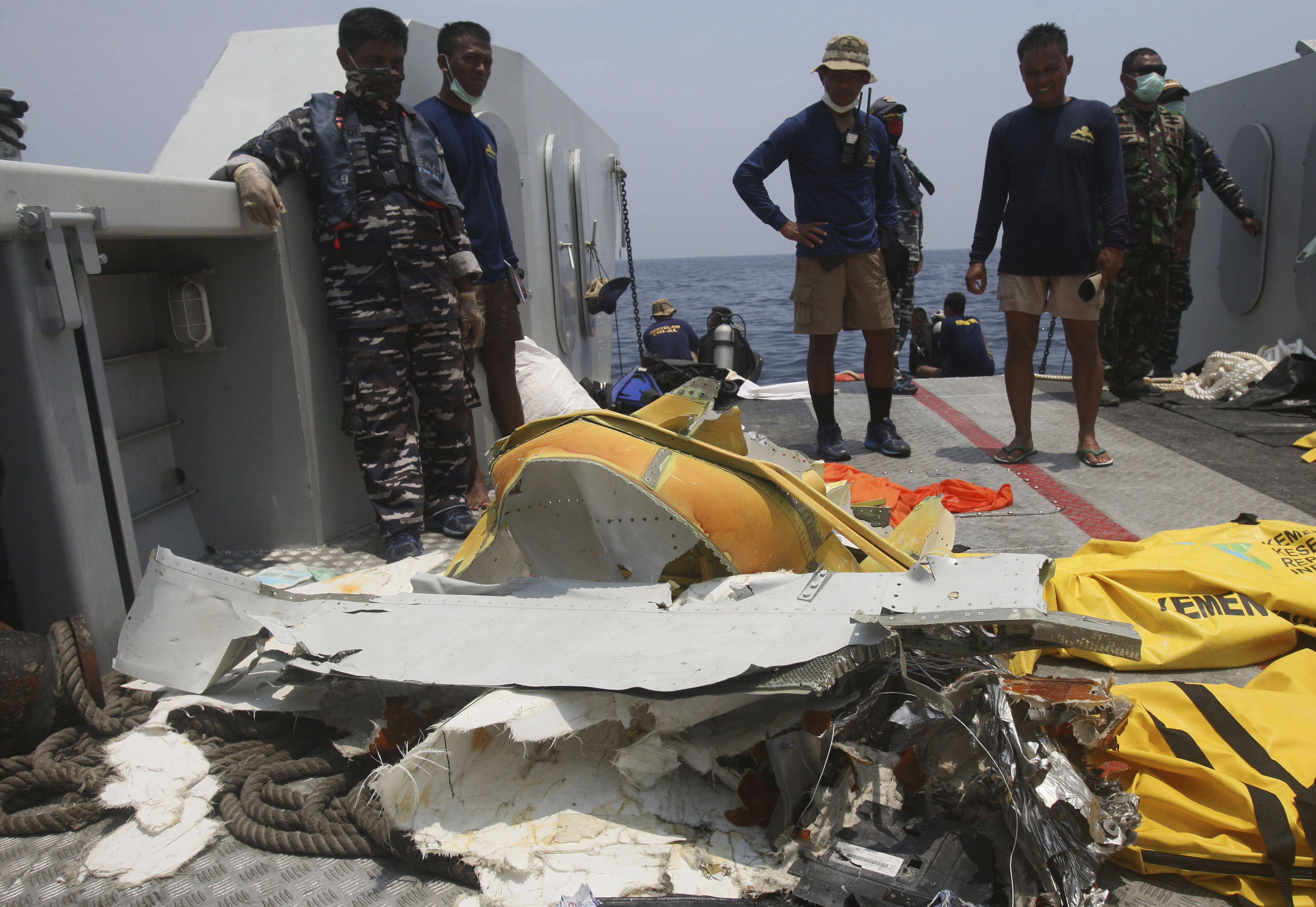 Navy divers inspect parts of the Lion Air aircraft that crashed into the sea during a search operation for the victims in the waters of Tanjung Karawang, Indonesia, Nov. 1, 2018.