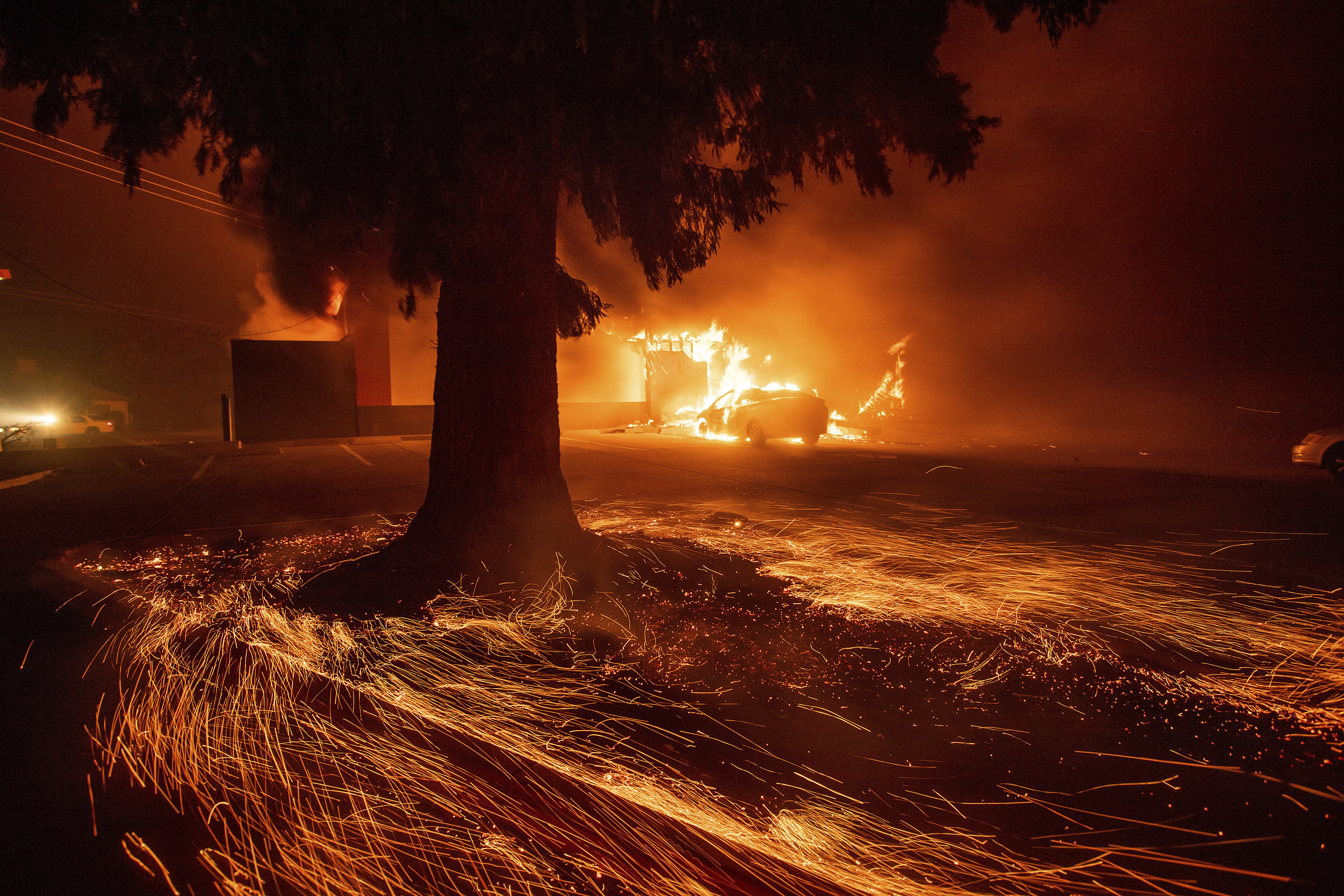 Flames consume a Kentucky Fried Chicken as the Camp Fire tears through Paradise, Calif., on Thursday, Nov. 8, 2018.