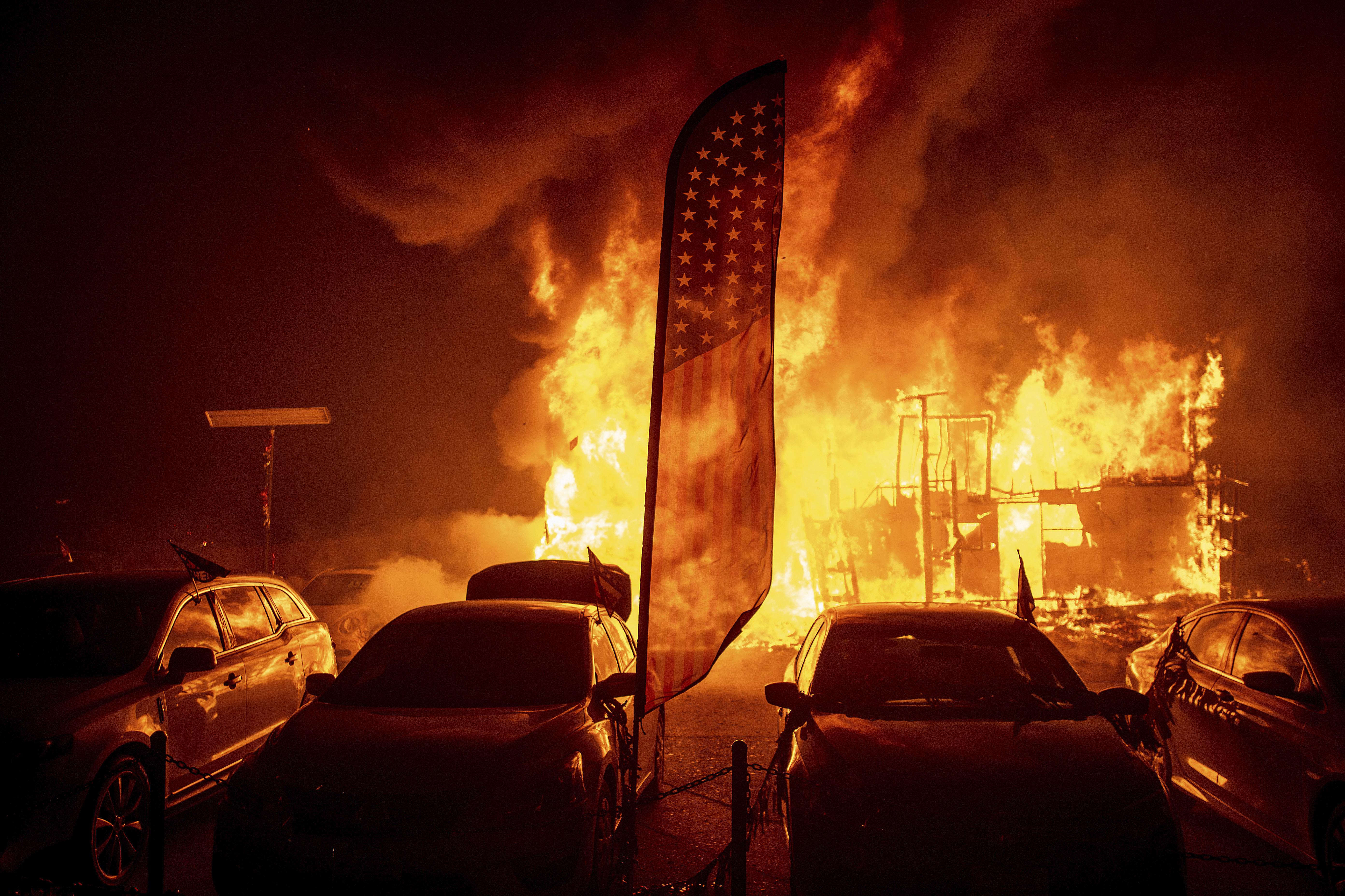 Flames consume a car dealership as the Camp Fire tears through Paradise, Calif., on Thursday, Nov. 8, 2018.