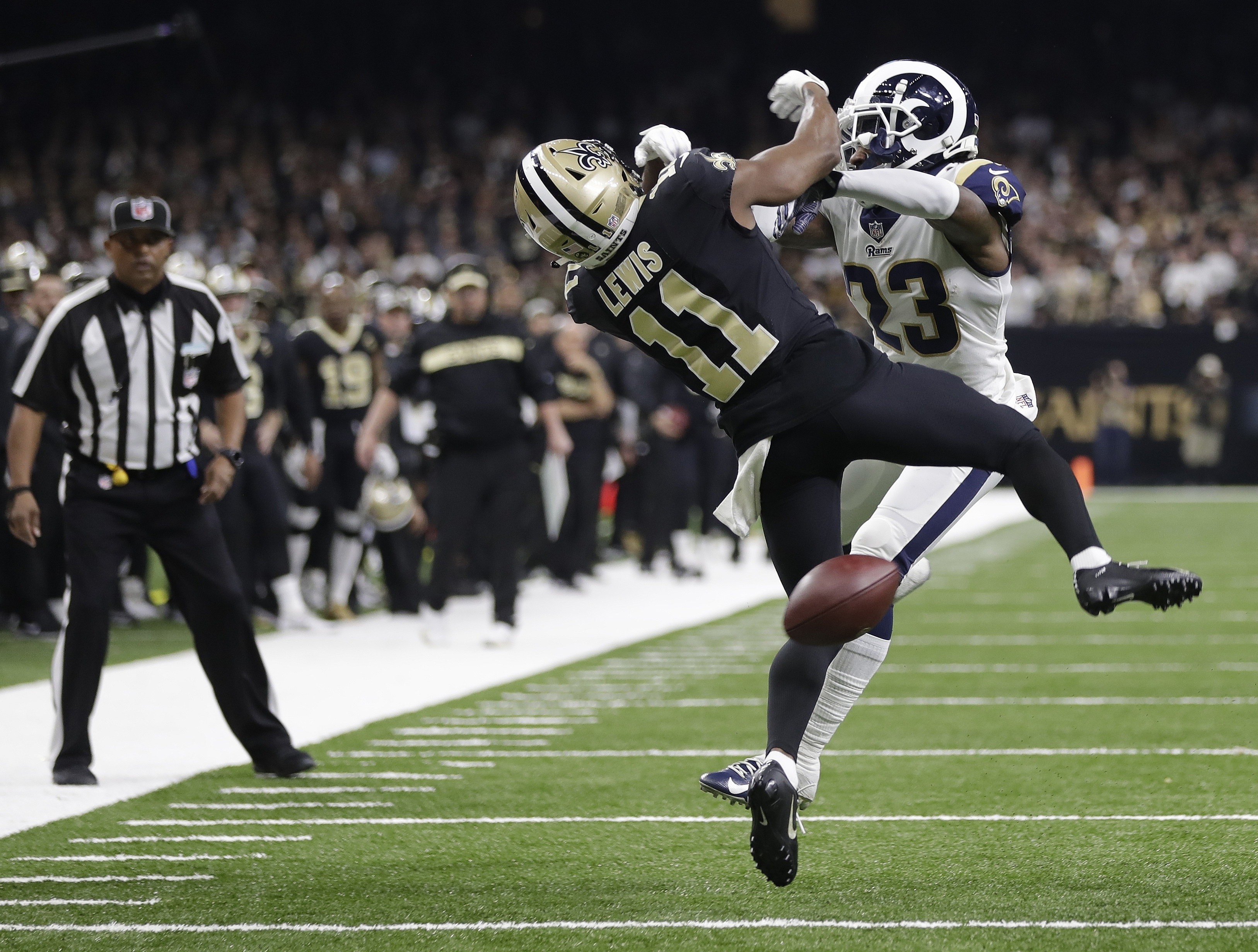 FILE-New Orleans Saints wide receiver Tommylee Lewis (11) works for a catch against Los Angeles Rams defensive back Nickell Robey-Coleman (23) during the NFC championship game.
