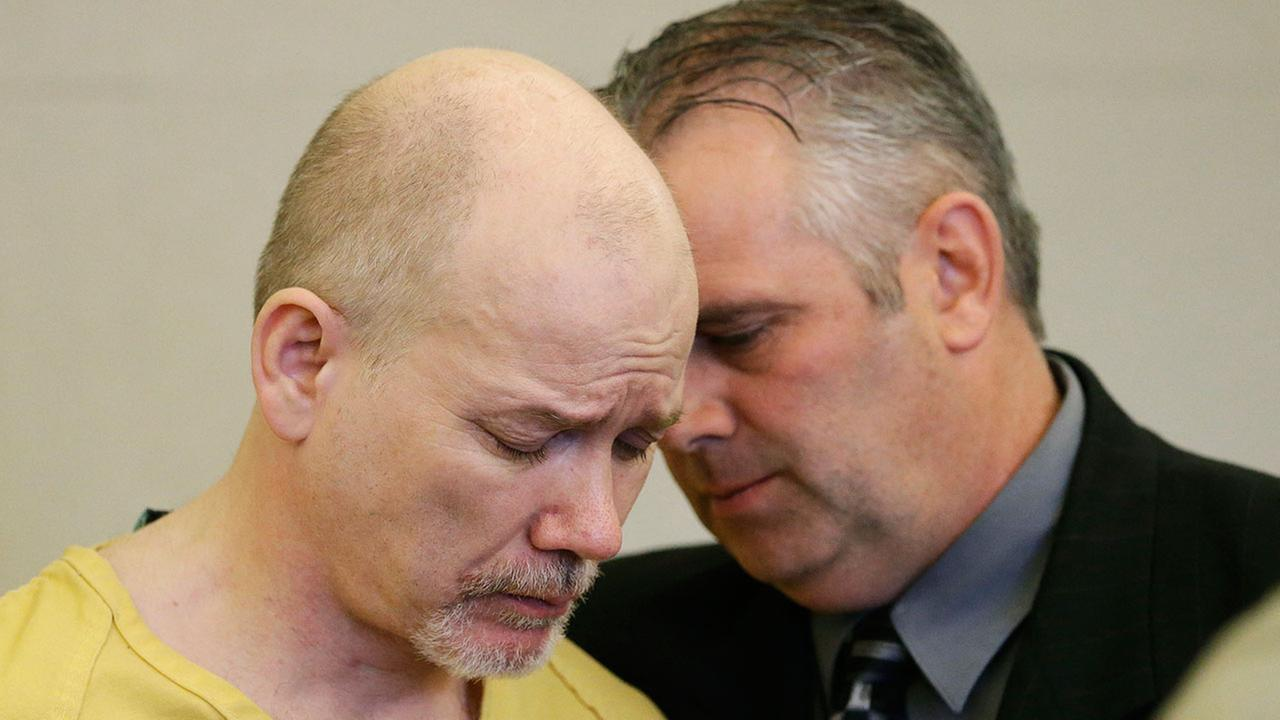 Troy Morley, who pleaded guilty to trying to kidnap a young girl from her bedroom in an attempt thwarted by the childs father, speaks with his defense attorney Roger Kraft during