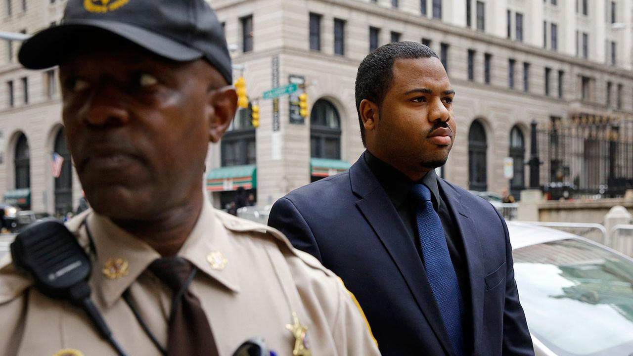 Officer William Porter, right, walks into  court in Baltimore. Jurors failed to reach a verdict in the case and the judge declared a mistrial. (AP Photo/Patrick Semansky)