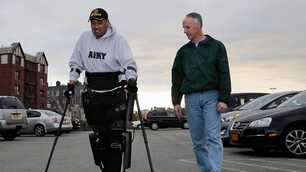 The Department of Veterans Affairs has agreed to pay for robotic legs that could allow scores of paralyzed veterans with spinal cord injuries to walk again. (AP Photo/Mel Evans)