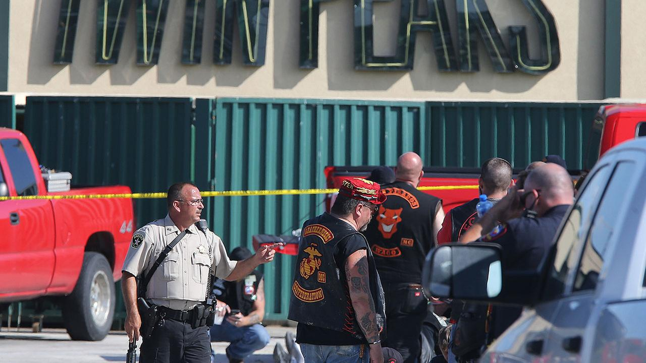 FILE - In this May 17, 2015 file photo, authorities investigate a shooting in the parking lot of the Twin Peaks restaurant in Waco, Texas.