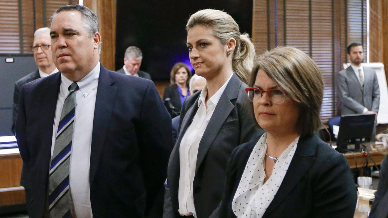 Sportscaster and television host Erin Andrews, center, stands with attorney Scott Carr, left, as the jury enters the courtroom Monday, March 7, 2016 (AP Photo/Mark Humphrey, Pool)