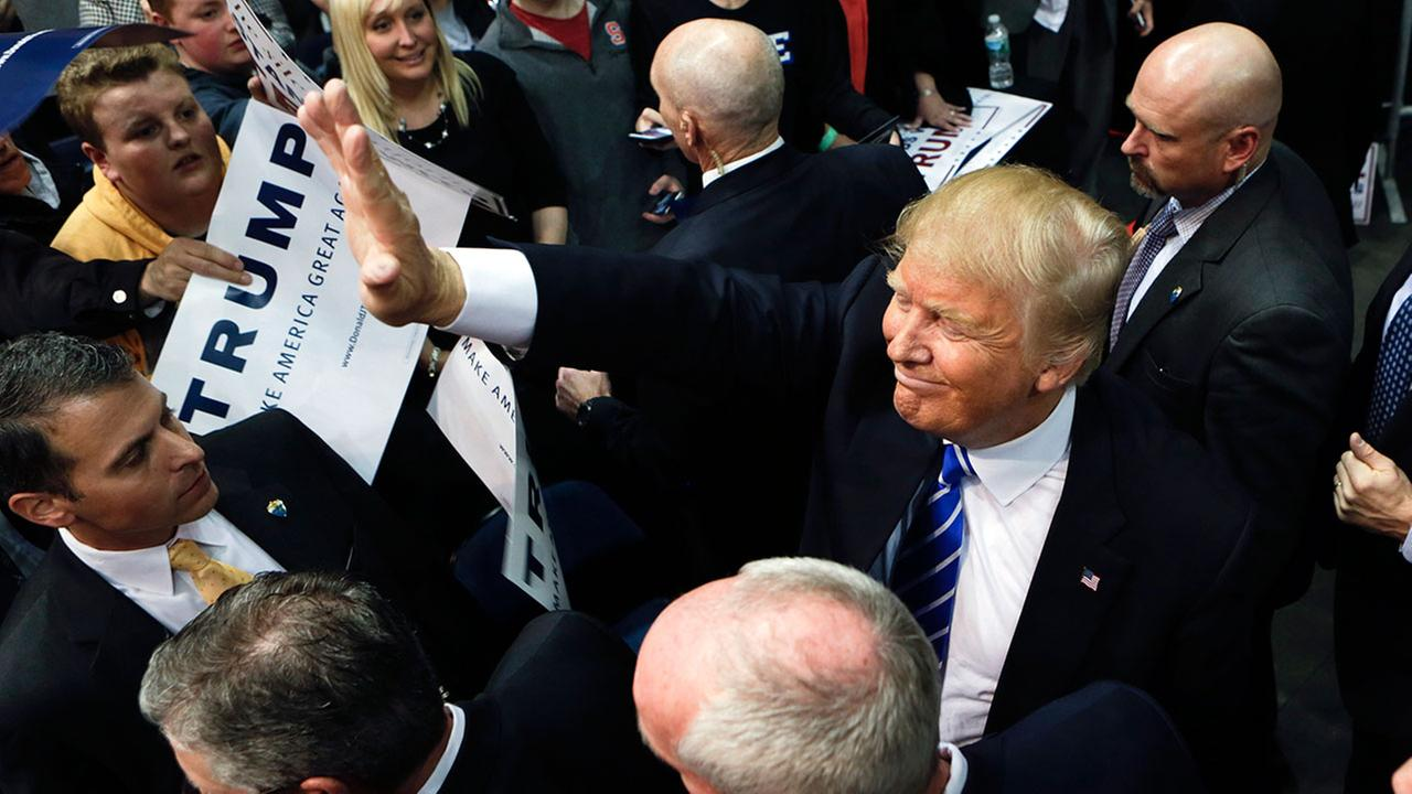 Republican presidential candidate Donald Trump waves to supporters after a rally at the Times Union Center on Monday, April 11, 2016, in Albany, N.Y. (AP Photo/Mike Groll)