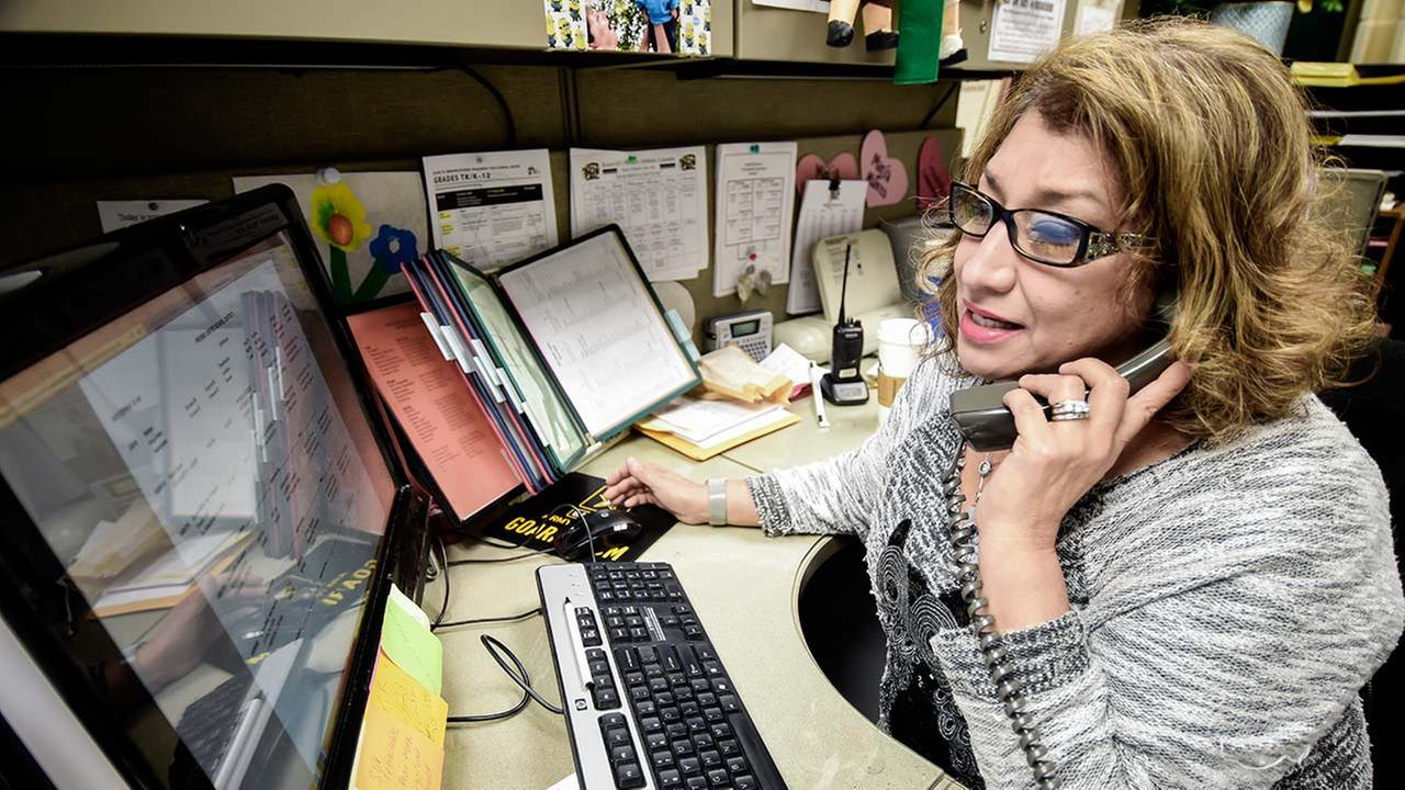 Rosemary Galvan-Reyes, the attendance clerk at Roosevelt High School, gets to know families to help students have better attendance.