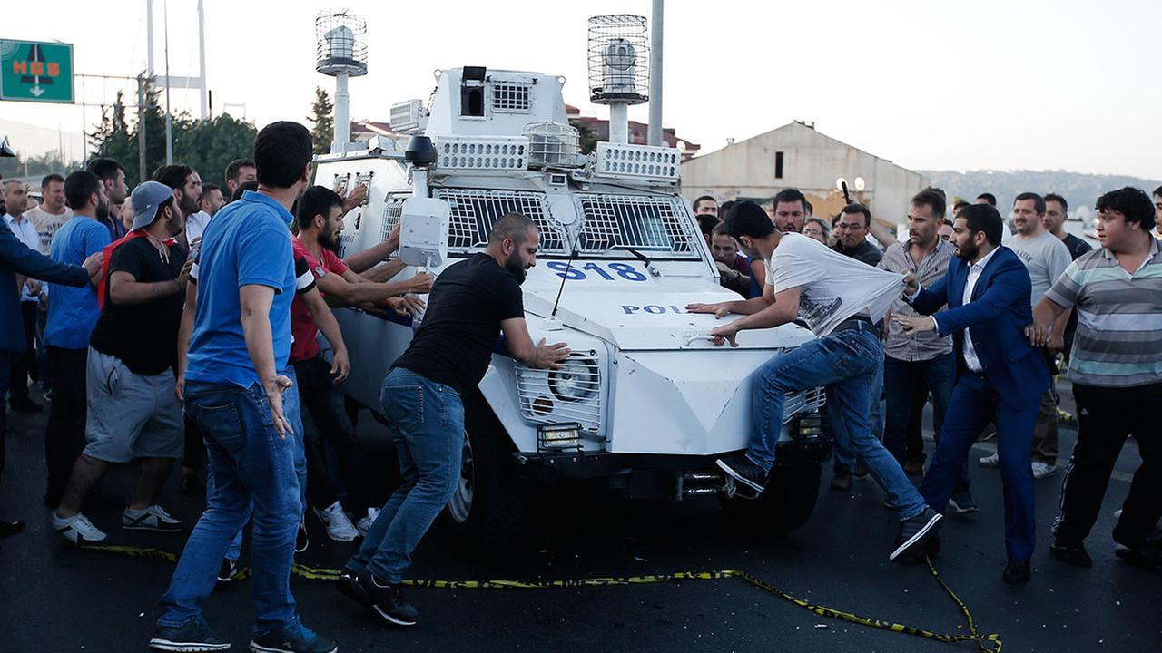 People attack and try to stop a Turkish police armored vehicle, carrying Turkish soldiers that participated in the coup and surrendered. (AP Photo/Emrah Gurel)