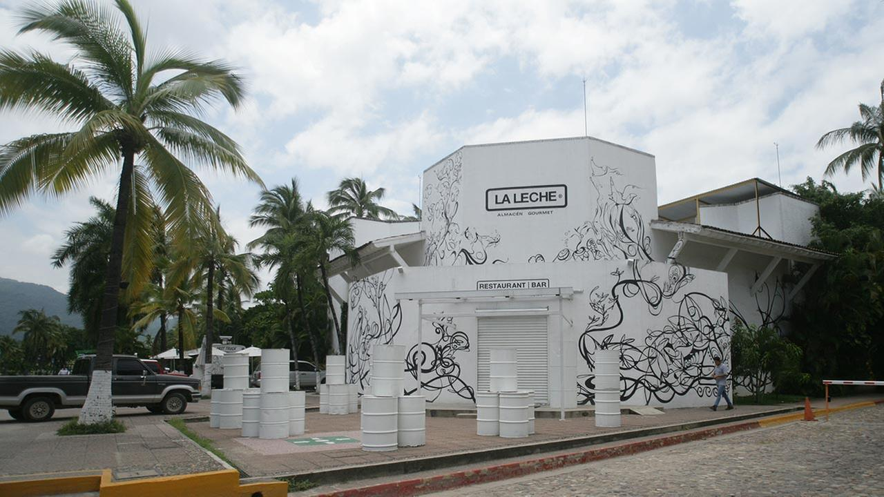 The entrance of the restaurant La Leche stands closed after armed men abducted as many as 16 people who were dining in the upscale restaurant in Puerto Vallarta