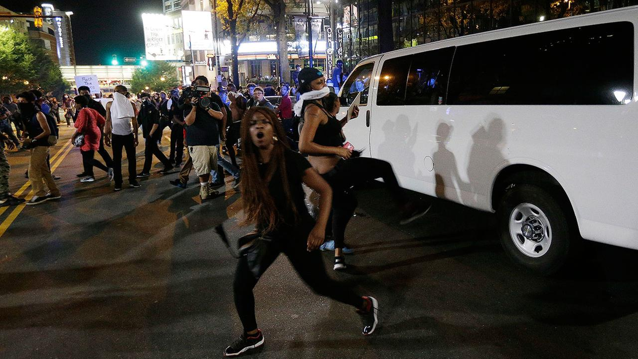 Demonstrators protest Tuesdays fatal police shooting of Keith Lamont Scott in Charlotte, N.C. on Wednesday, Sept. 21, 2016.(AP Photo/Chuck Burton)