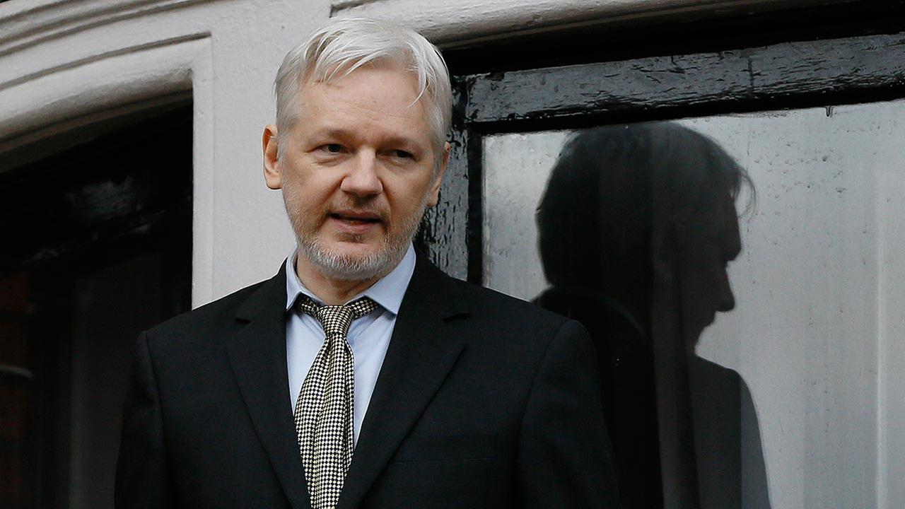 FILE - In this Feb. 5, 2016 file photo, WikiLeaks founder Julian Assange speaks from the balcony of the Ecuadorean Embassy in London.
