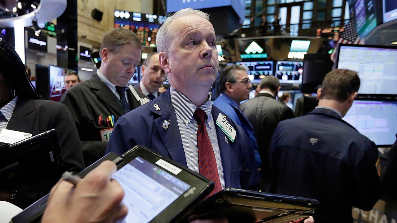 Trader James Riley works on the floor of the New York Stock Exchange, Friday, May 5, 2017.