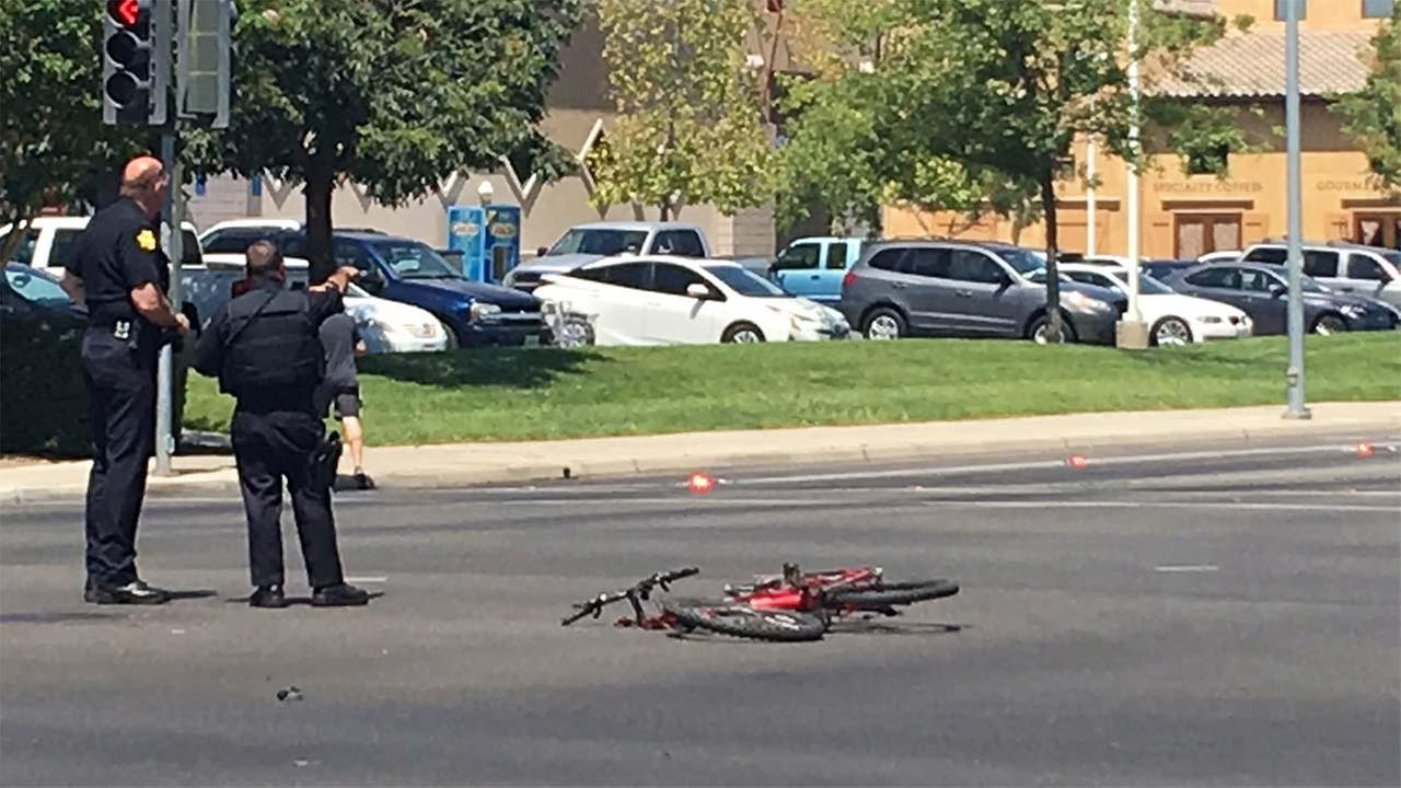 Bicycle rider killed after running red light, hitting car, Fresno police say