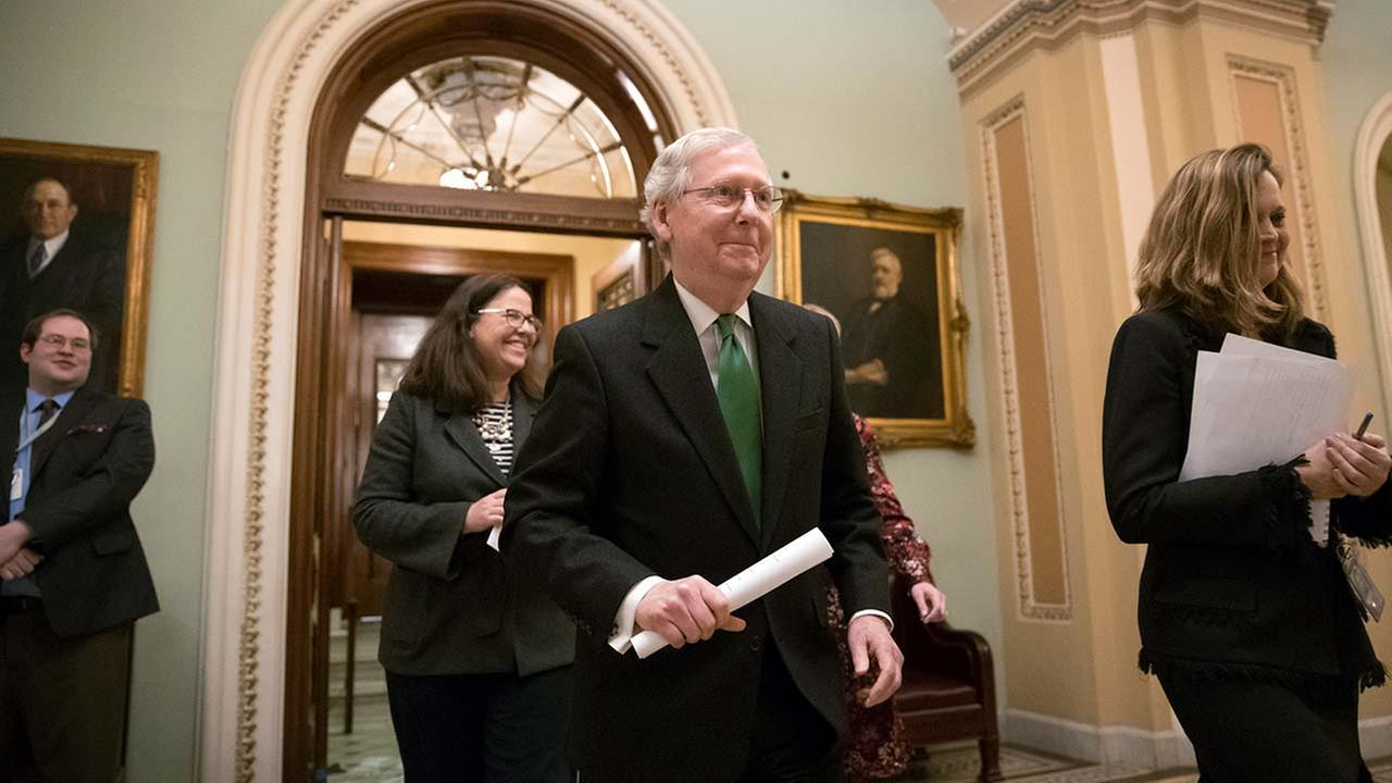 Senate Majority Leader Mitch McConnell, R-Ky., leaves the chamber after announcing an agreement in the Senate on a two-year budget deal. (AP Photo/J. Scott Applewhite)