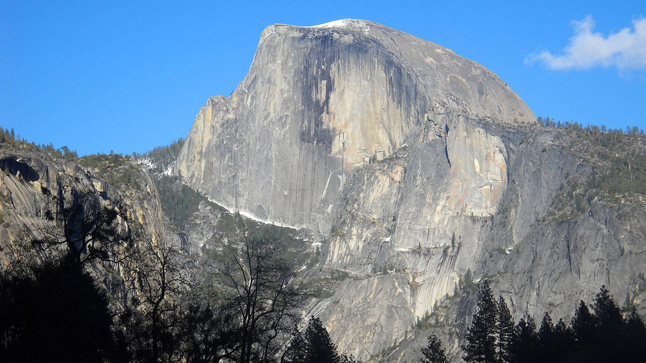 This April 2013 image shows Half Dome, the iconic granite peak in Yosemite National Park in California. (AP Photo/Kathy Matheson)