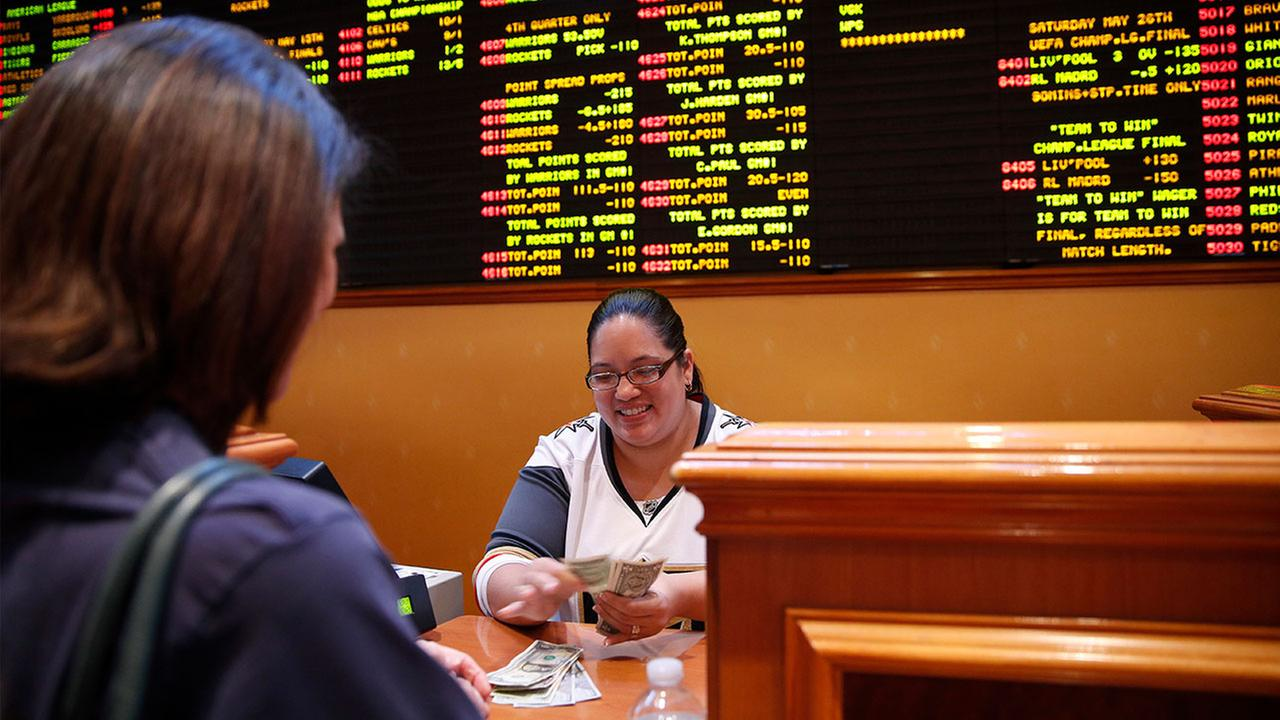 Crystal Kalahiki pays out a bet in the sports book at the South Point in Las Vegas. The Supreme Court gave its go-ahead for states to allow gambling on sports across the nation.