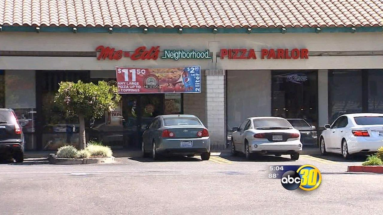 Armed robber holds up Merced Me-N-Eds Pizza restaurant