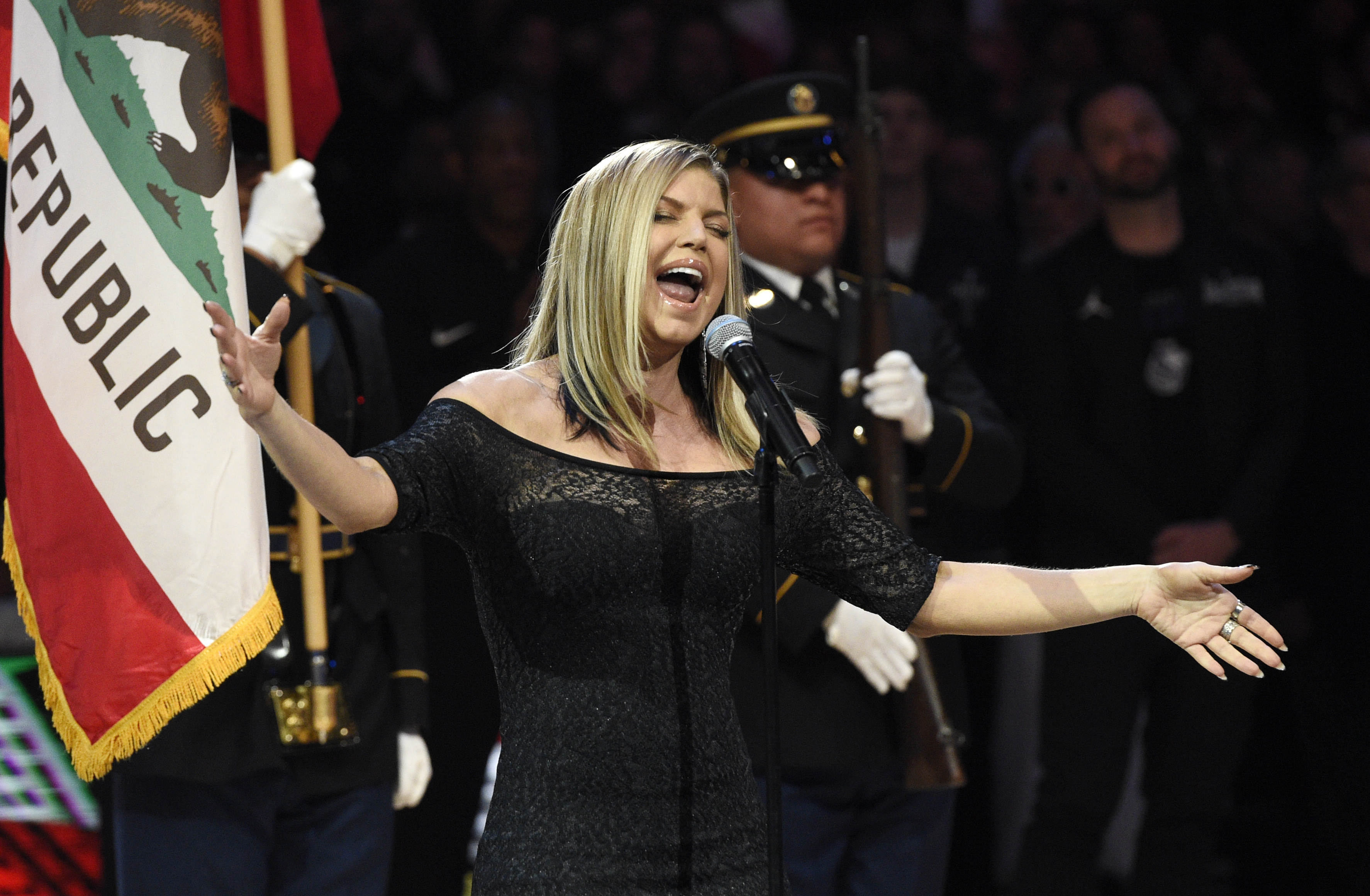 In this Sunday, Feb. 18, 2018, photo, Fergie performs the national anthem before the start of the NBA All-Star basketball game in Los Angeles.