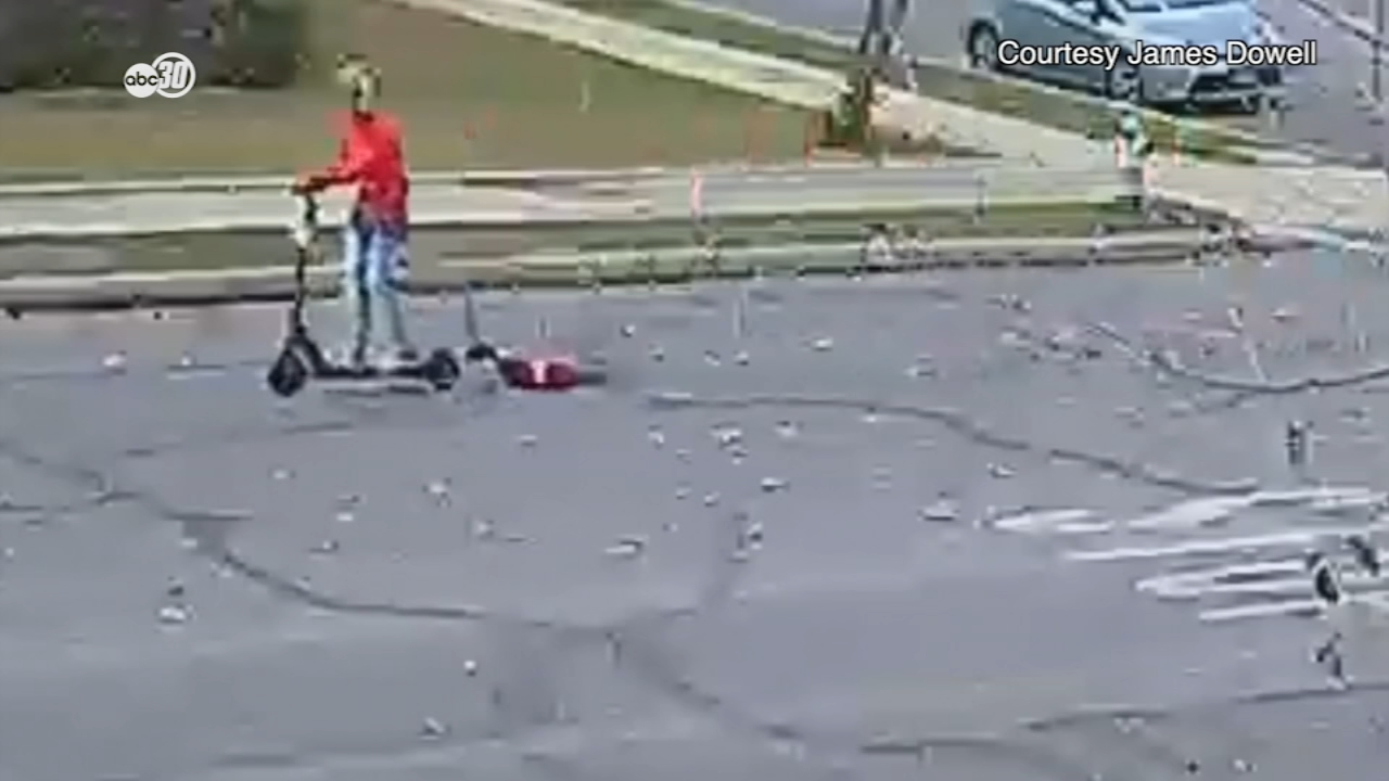 Shocking videos from Bakersfield show a woman dragging a small dog behind her while riding a scooter. WARNING: The video may be disturbing to some.